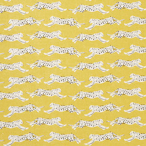 Schumacher Leaping Leopards fabric swatch in yellow